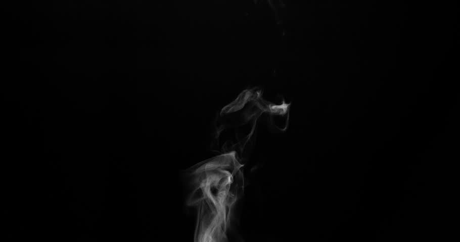 Steam from a Cup of Hot Water. White steam rises light, graceful twists on a black background. Shooting at a rate of 120fps. Footage is perfect for the top layer with different blending modes #19649809