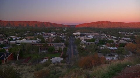 Sunrise over Alice Springs from the Anzac Hill lookout. This clip starts with the hills partially lit by the sun.