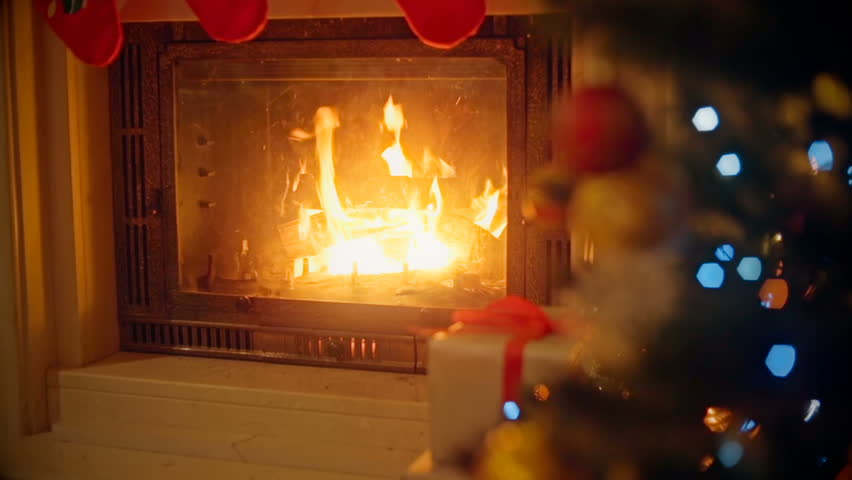 Background With Decorated Christmas Tree And Burning Fireplace At Living Room Focus On