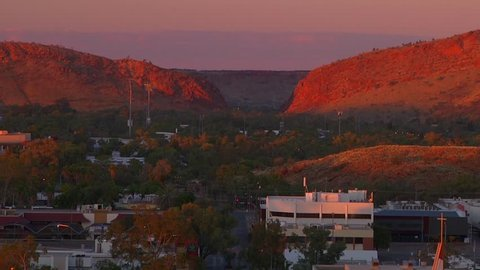 Sunrise at Alice Springs from Anzac Hill. The sun lights the MacDonnell Ranges as it rises over Alice Springs, Northern Territory, Australia,