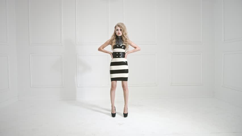 Fashion model striking a pose, Red Epic 4k slow motion clip