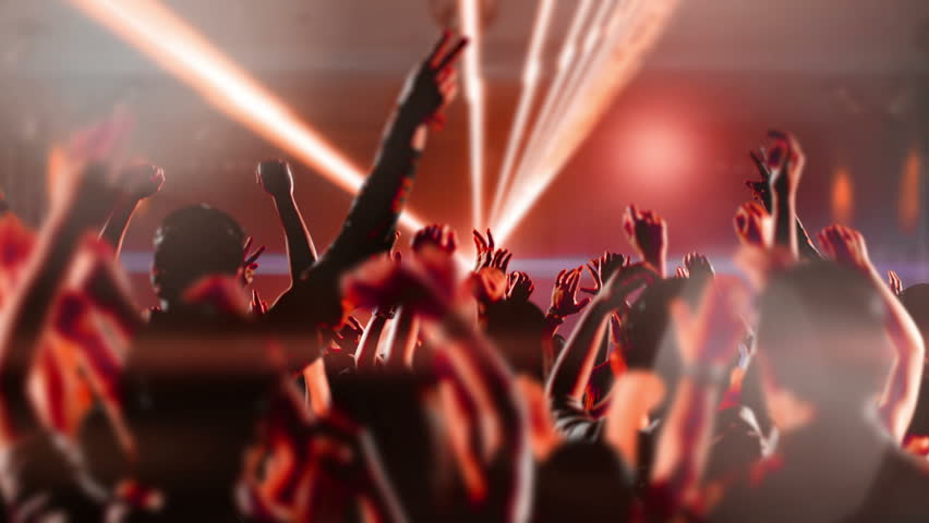 Footage of a crowd partying, dancing at a concert. Shot on RED EPIC Cinema Camera in slow motion.