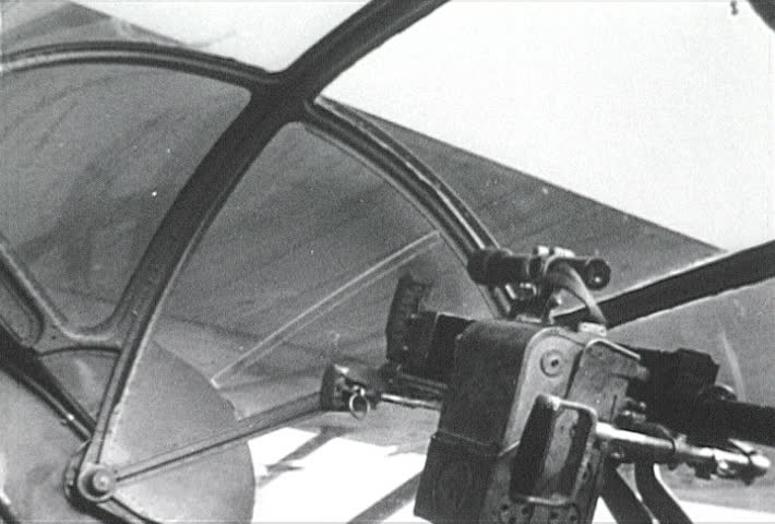 ATLANTIC OCEAN - CIRCA 1942-1944: World War II, U.S. Naval Pilot In Cockpit with Binoculars, publisher National Broadcasting Service (U.S.)