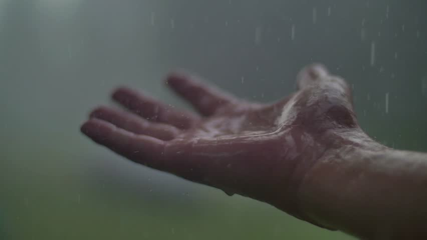Man hand in the rain and hail | Shutterstock HD Video #19731109