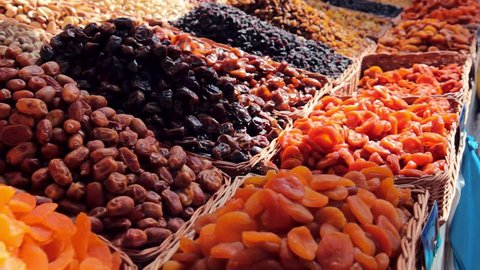 Raisins. Dried fruits. Nuts. Dried food and nuts on the market stall. Dry fruits on the market.