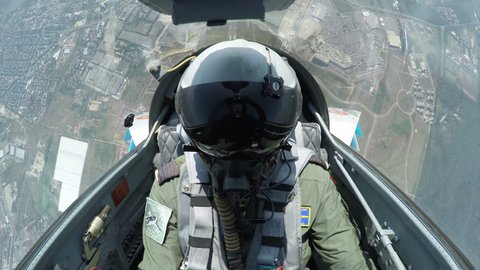 POV shot from the cockpit of a fighter plane.