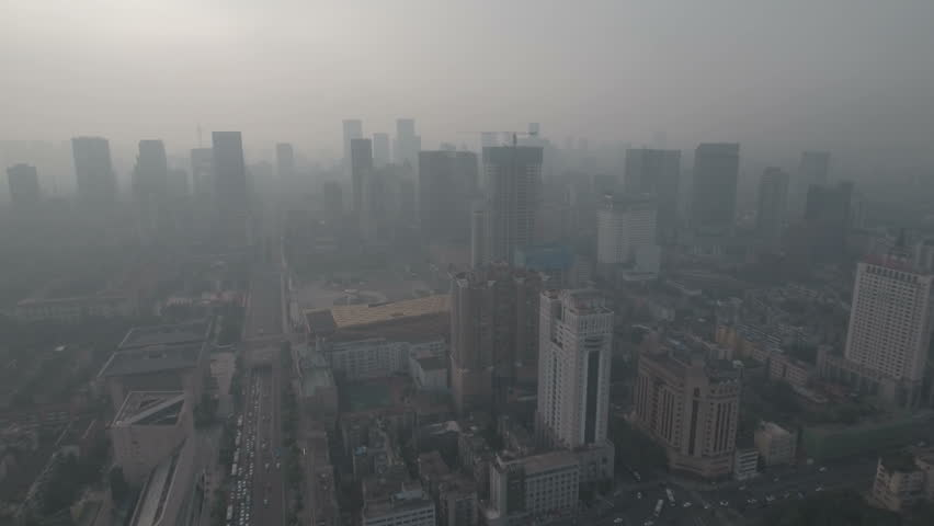 Flying towards downtown Chengdu in central China, smog and air pollution on a hazy day. D-log profile DJI Phantom.