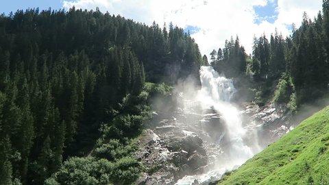 Krimml Waterfalls in Pinzgau, Salzburger Land at Austria. European Alps landscape with forest.