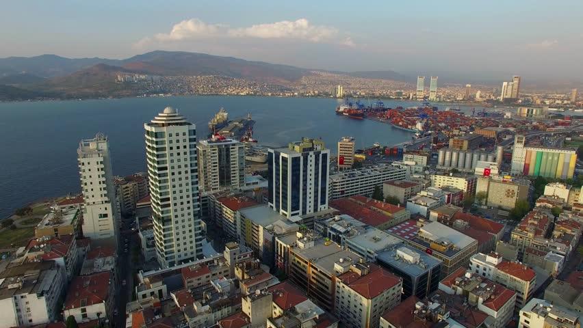 Izmir city center with coastline, ferries and fair. Turkish city, drone shot
