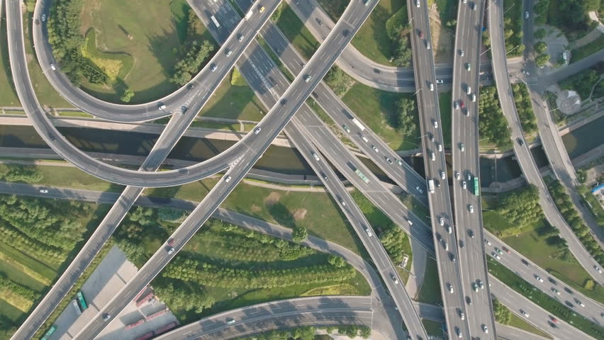 Panoramic aerial footage of a huge network of flyovers, junctions, intersections, roads, bridges etc in Zhengzhou, urban China.