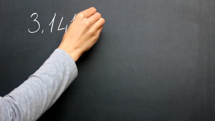 Writing Pi. Writing pi number on the blackboard.