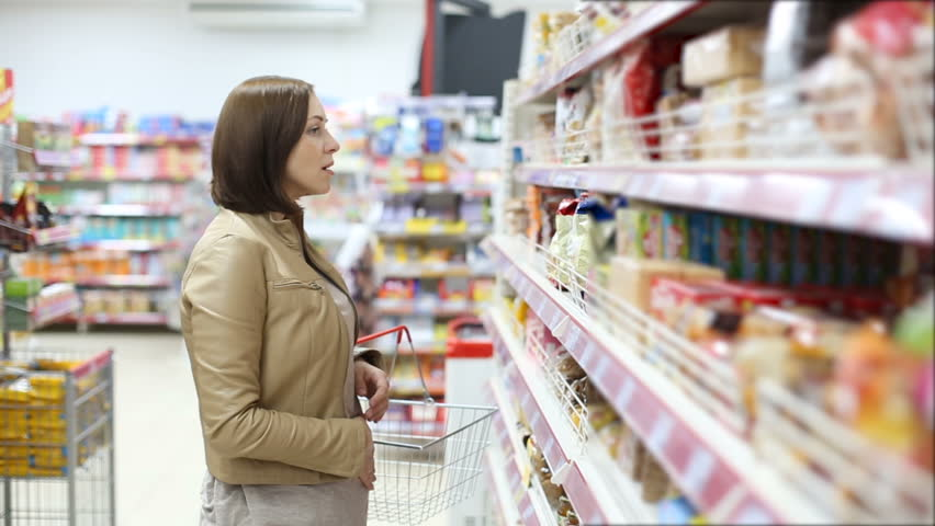 Woman checking food labelling | Shutterstock HD Video #19954285