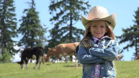 4K Portrait of Farmer Child with Cows, Cowherd Little Girl Face Pasturing Cattle