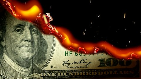 Dollar bill USA money burning in flames, economic crisis or inflation concept. UHD