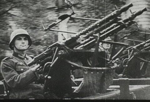 EUROPE - CIRCA 1942-1944: World War II, Armed Nazi Soldiers Ride on Tanks