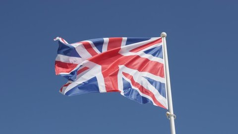 Union Jack national Great Britain symbol waving on flag-pole against blue sky 4K 2160p 30fps UHD footage - Flag of United Kingdom floating on wind 3840X2160 UltraHD video