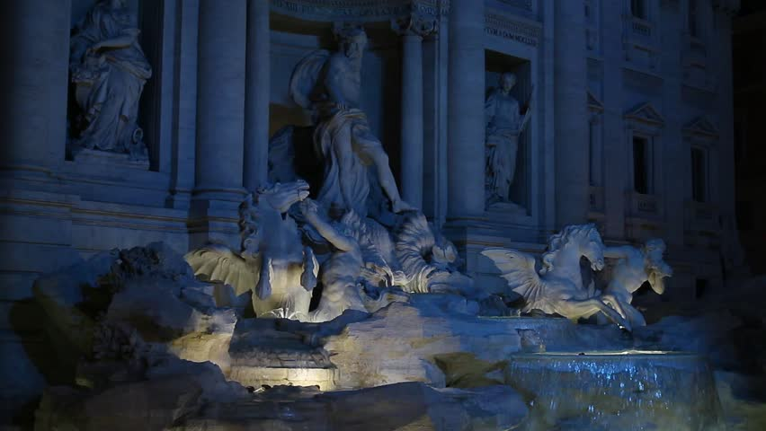 Fontana Di Trevi (Trevi Fountain) at night with blue lights in Rome
