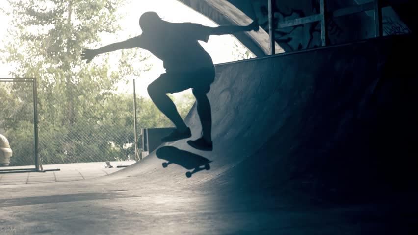 Skateboarder on skate doing flip tricks slow motion HD video on ramp skateboard park. Urban extreme sport lifestyle