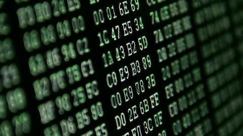 Hexadecimal code running up a computer screen. Green-ish digits. Close-up shot. Shallow depth of field.
