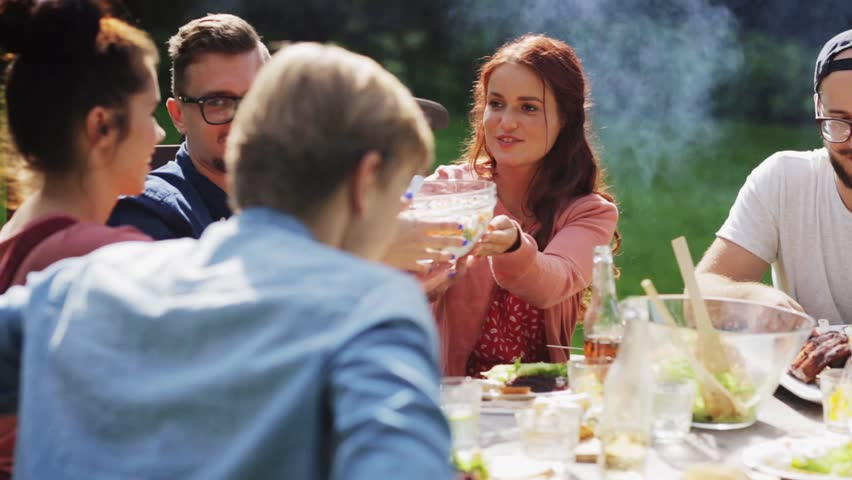 Leisure, holidays, eating, people and food concept - happy friends having dinner at summer garden party | Shutterstock HD Video #20117989