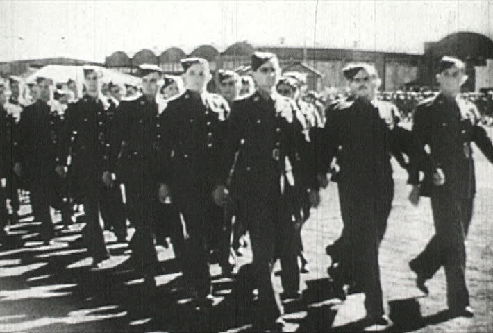 EUROPE - CIRCA 1942-1944: World War II, Soldiers March with Determination