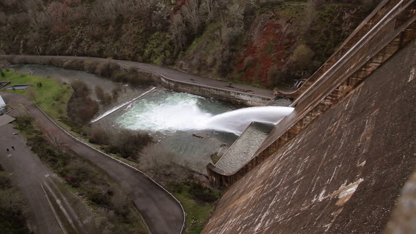 Side view of huge gush of water coming at the point of evacuation of a dam or reservoir dam   | Shutterstock HD Video #20120209
