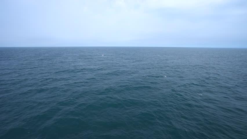 Aerial shot of open ocean. Blue sky and horizon. | Shutterstock HD Video #20123212