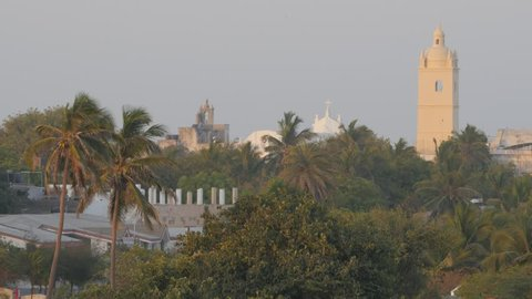 Diu,India - April 01,2016: Tower above palm trees