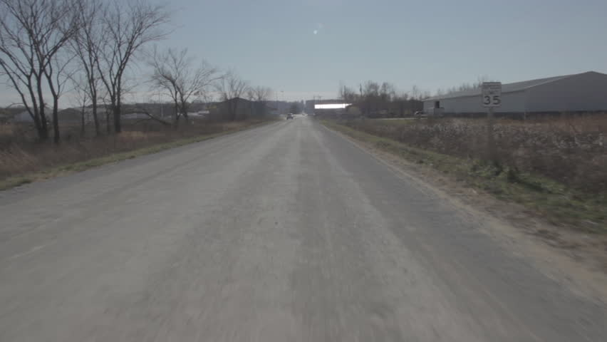 Passing Warehouses Along a Country Road