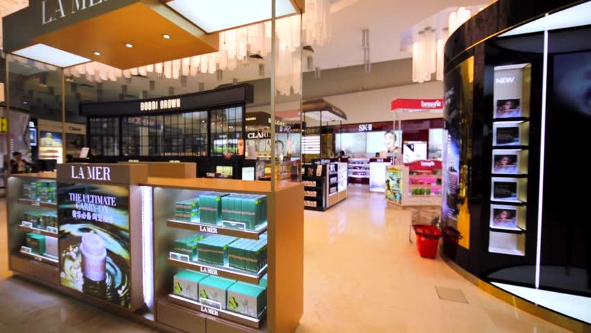 KUALA LUMPUR, MALAYSIA - APRIL 7, 2016: Stores of different beauty brands in duty free zone in KL Internationl airport: Lamer, Bobbi Brown, Bvlcari, Gucci, Biotherm, SK-II, Giorgio Armani, etc