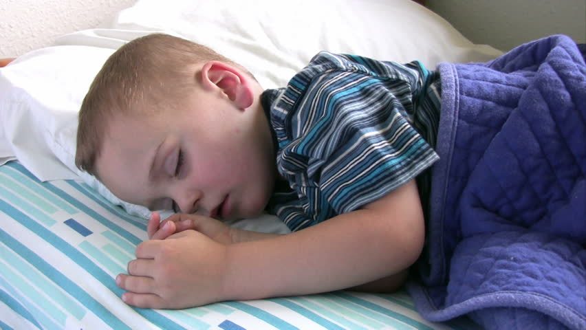 Boy sleeping in his bed.  HD 1080i