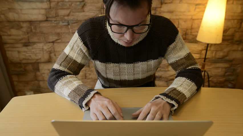 Angry man using laptop computer