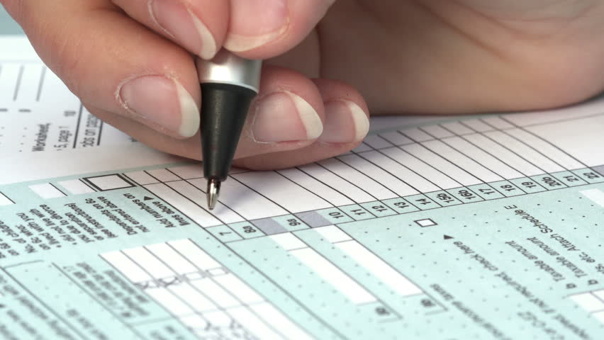 fill out your US tax return: tax form 1040, the young woman's hand writing