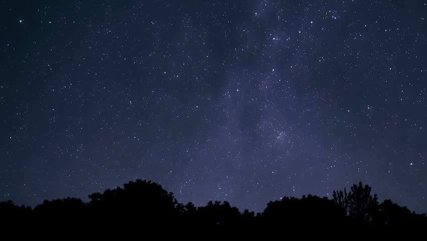 Time lapse video of starry Milky Way slowly fading with the first rays of morning sun