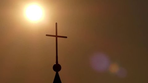 Amazing Sun Set and Church Cross in Time Lapse. the Sun Passes Through the Cross of the Church.