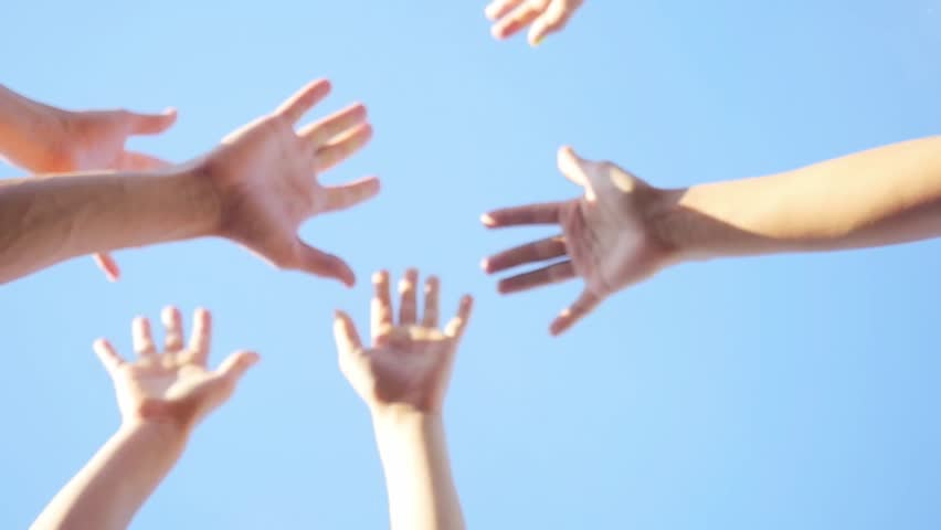 Successful team: many hands holding together on sky background in slowmotion. 1920x1080 | Shutterstock HD Video #20240959