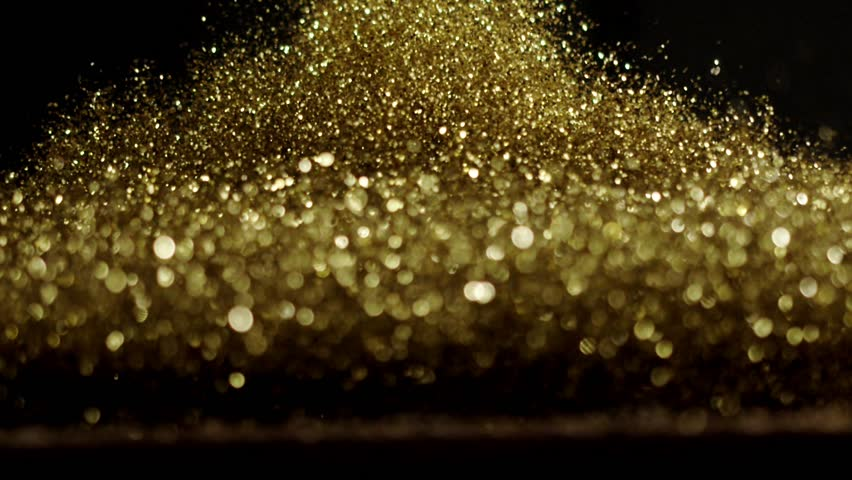 Golden glitter exploding , Red Epic slow motion clip