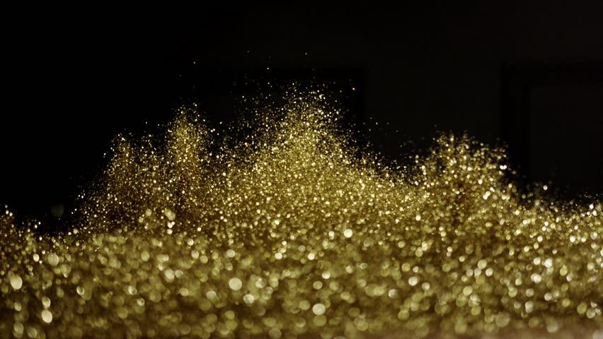 Golden glitter exploding , Red Epic slow motion clip