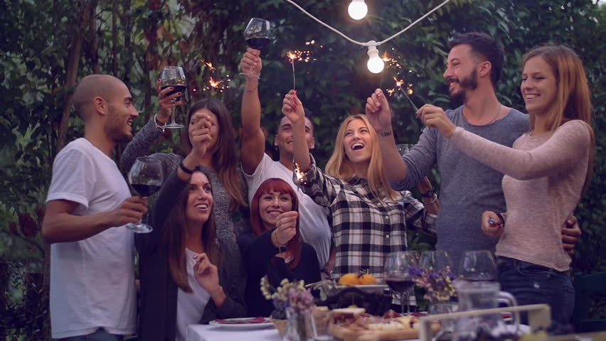 Attractive Dinner Party Video Part - 13: Friends Holding Lit Sparklers At A Dinner Party - 4K Stock Video Clip