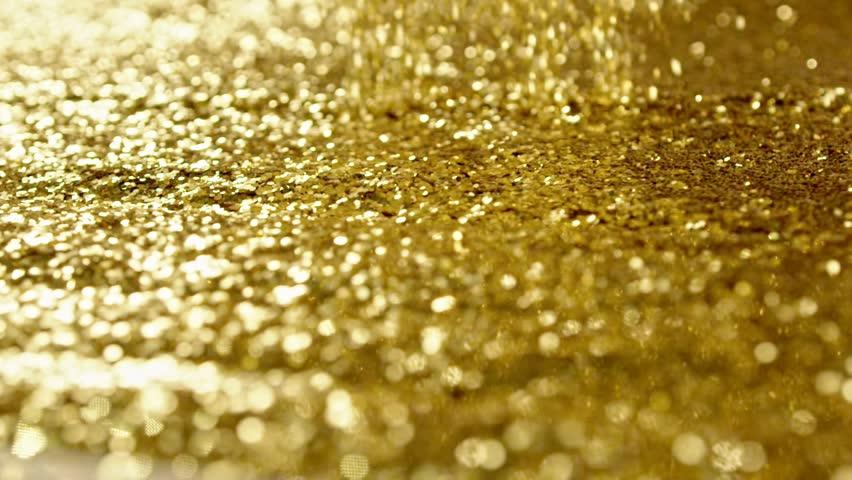 Golden glitter dynamic movements in slow motion | Shutterstock HD Video #20271619