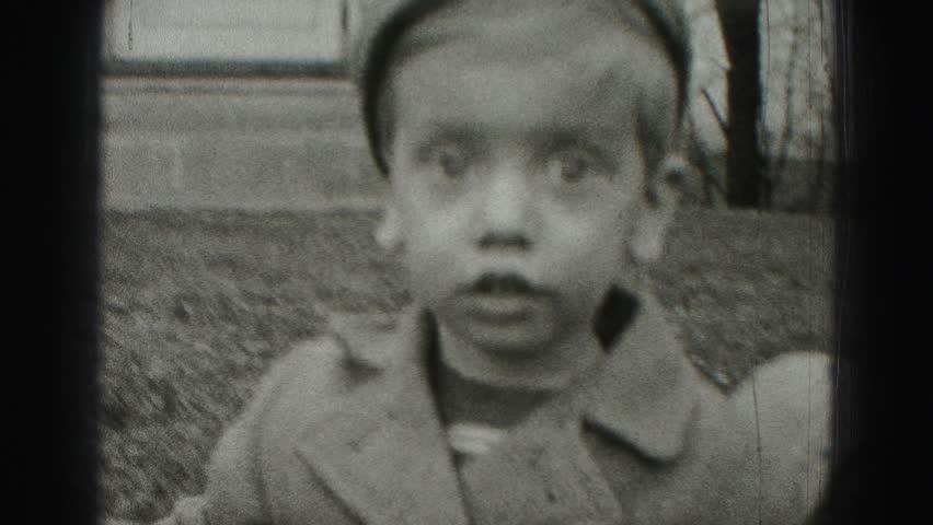 HARRISBURG 1946: big eyed poor boy with paperboy style fashion hobo dress