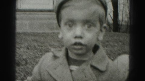 HARRISBURG 1946: big eyed poor boy with paperboy style fashion hobo dress
