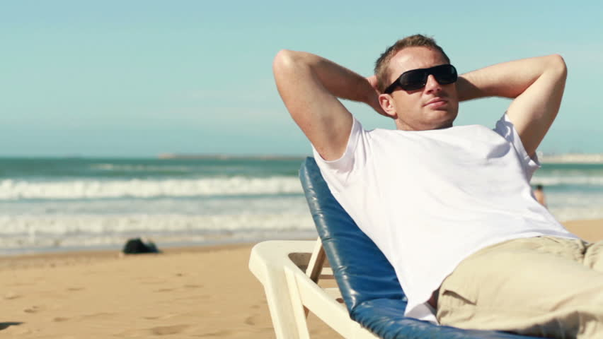Happy Young Man Relaxing On Stock Footage Video 100 -4263
