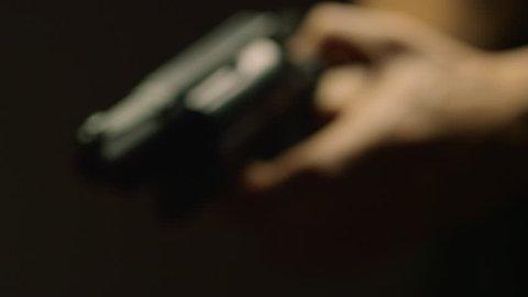 Hand Gun Being Pointed IX
