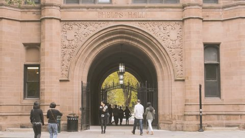 NEW HAVEN, CT- OCT 8: Students walking through Yale University college campus on October 8, 2016. Yale University is a prestigious Ivy League university school founded in 1701.