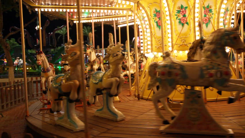 Pony rides on a merry-go-round carousel