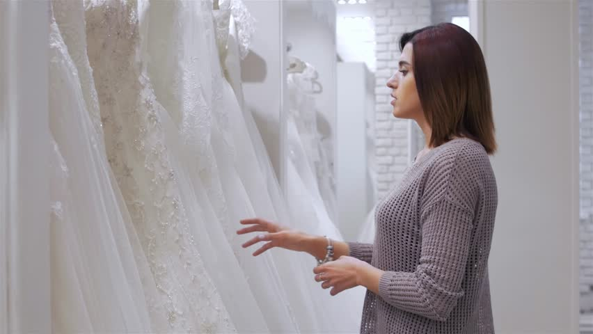 Two young beautiful brides trying her dress in shop. Wedding concept. | Shutterstock HD Video #20357359