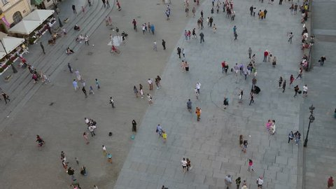 Warsaw, Poland, August 2016: Aerial drone view long shot of lively crowd of people walking in the streets of old town of Warsaw