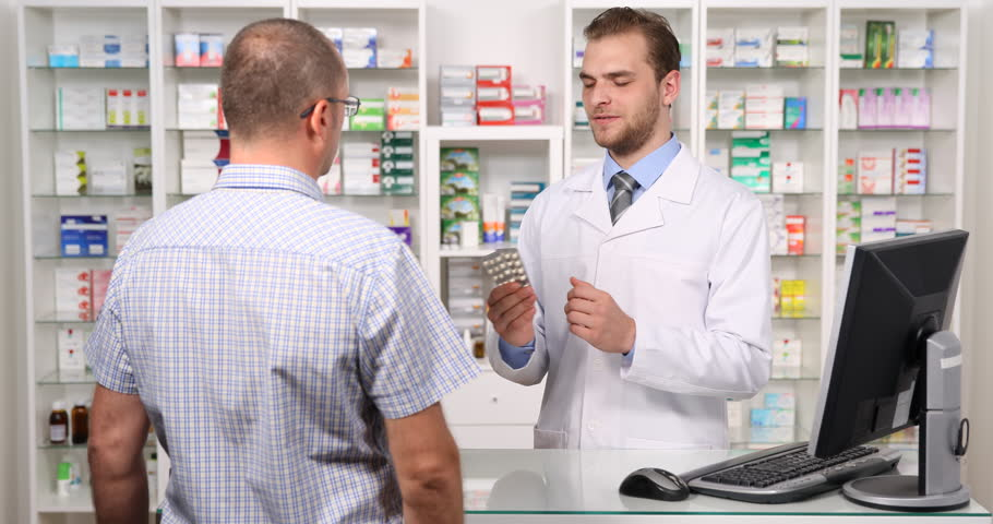 pharmacist man explaining to patient medicine pill information pharmacy dialogue ultra high definition ultrahd ultra hd uhd 4k 2160p 4096x2160 stock - Drug Information Pharmacist