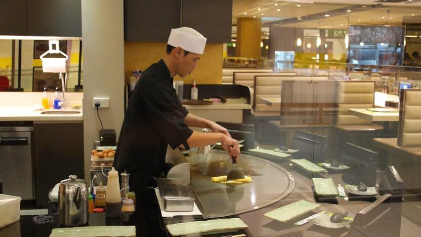 Restaurant Kitchen Video male chefs in hotel or restaurant kitchen working and washing